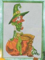 Ведьмочка на тыкве