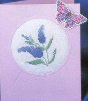 Синие цветы и бабочка